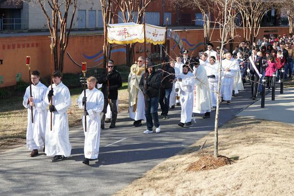 Seminarians lead the Eucharistic Procession for Life through Riverfront Park Jan. 19 before the Mass for Life. Father John Connell carried the monstrance for more than a mile around the park and down Markham Street. (Malea Hargett photo)