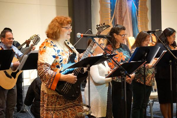 Elizabeth Reha (left) leads Our Lady of Good Counsel Church's bilingual choir during the Mass for Life. (Malea Hargett photo)