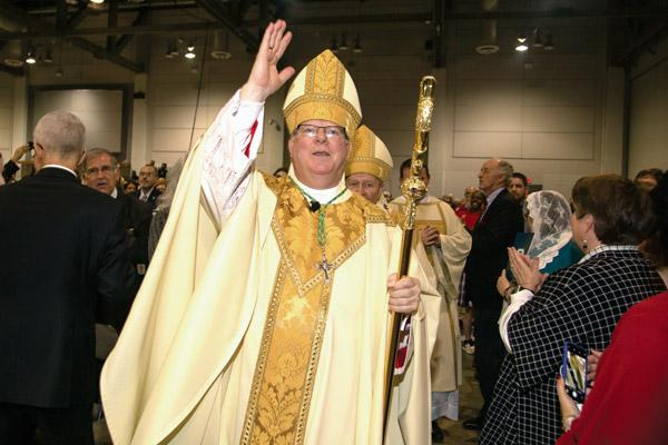 At the end of Mass, Bishop Francis I. Malone walks through the crowd, blessing the congregation for the first time as a bishop. The crosier was used by the late Bishop Andrew J. McDonald and was lent to Bishop Malone to use while he serves in Shreveport. (Bob Ocken photo)