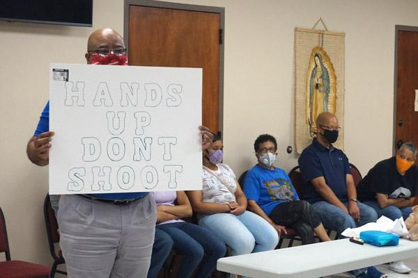 "The dialogue on racism surrounded common phrases like ""Hands up, don't shoot,"" held here by a Diocesan Council for Black Catholics member. The listening session was held at the House of Formation in Little Rock on July 2. (Aprille Hanson photo)"