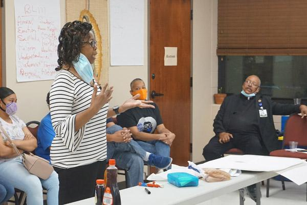 Alma Stewart, DCBC member and parishioner at St. Bartholomew Church in Little Rock, shares a story regarding racism she experienced as a child. Members of the council were encouraged to share their stories. (Aprille Hanson photo)