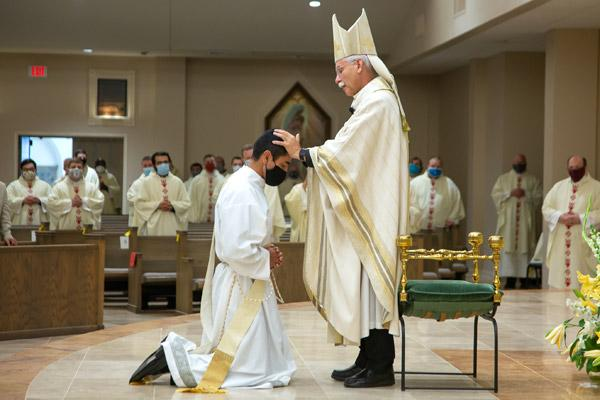 Bishop Anthony B. Taylor lays hands on Father Daniel Velasco in silence, to receive the strength of the Holy Spirit.