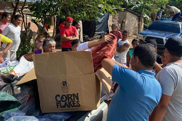 Residents of Trujillo, Honduras, receive clothes and other supplies Nov. 13 after Hurricane Eta, which destroyed houses and passages to several villages. (Courtesy Dixiana Hernandez)