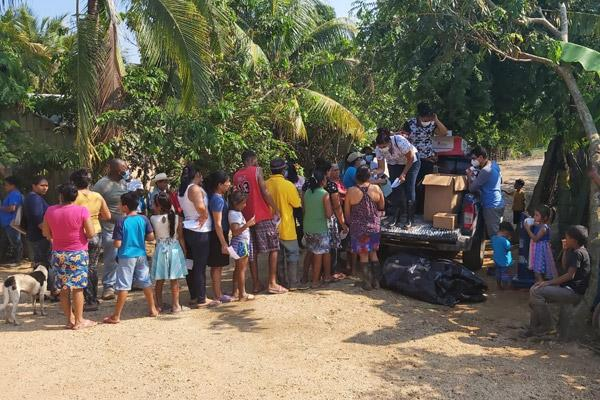 Residents of Trujillo, Honduras, line up for supplies on Nov. 12. The country, already hit hard with the COVID-19 virus, was flooded by rains from Hurricanes Eta and Iota in November. (Courtesy Father Gildo Ramírez)