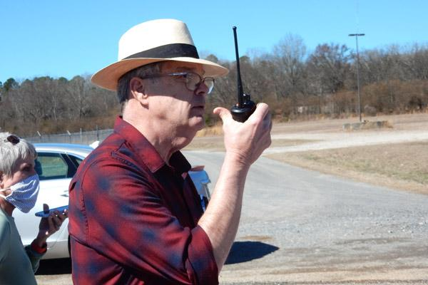Dr. Jack Porter, Oaklawn Center on Aging chairman, gives directions to volunteers at the vaccination event at the Garland County Fairgrounds arena in Hot Springs Feb. 23. (James Keary photo)